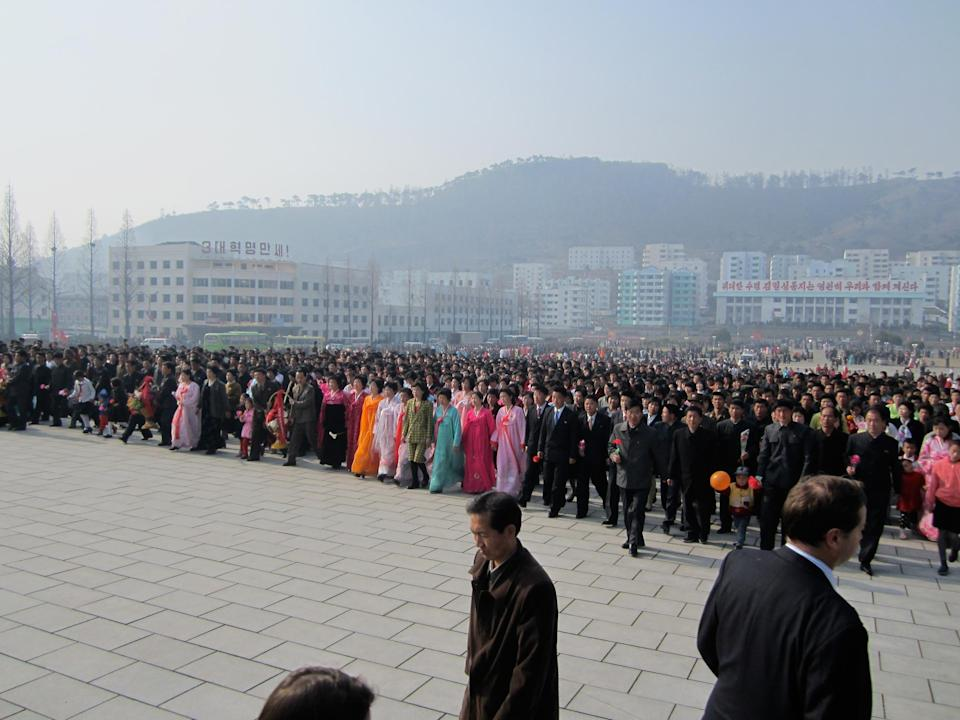 We spend the big day, 15 April, Kim Il-sung's birthday, in Pyongsong, a city some 40 miles from the capital. People here never see Western visitors and stare at us as if we've stepped off the set of <em>Star Wars</em>. At the ceremony I watch the entire citizenry advance in silence, holding flowers, toward a giant statue of Kim. It is one of the oddest experiences of my life, reminding me more of a scene from the Old Testament than of anything from the old communist bloc.