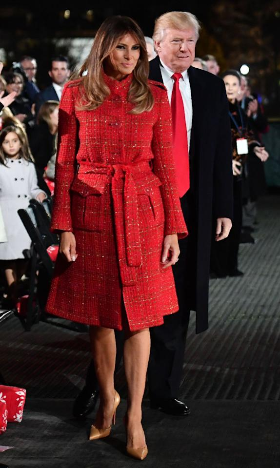 Wearing a festive red Chanel coat, Melania pushed the button to light the National Christmas Tree.