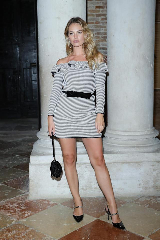 <p>'Mamma Mia! Here We Go Again' actress Lily James attended the Miu Miu Women's Tales Dinner during Venice Film Festival on 2 September in a monochrome mini dress. She kept accessories minimal and brought back the seventies waves we fell for in her latest silver screen hit. <em>[Photo: Getty]</em> </p>