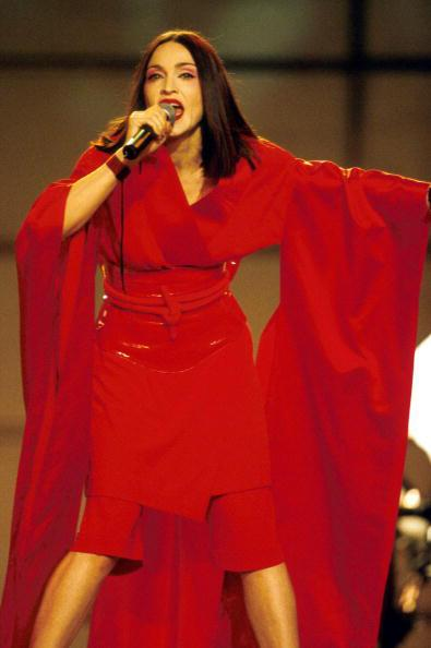 "<div class=""caption-credit""> Photo by: AP</div><div class=""caption-title""></div><b>Singing ""Nothing Really Matters"" at the Grammys, 1999</b> <br> Next transformation: a geisha-inspired look. Jean Paul Gautier made the kimono."
