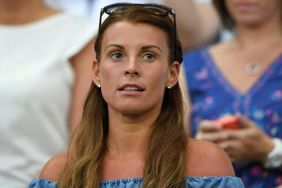 Coleen Rooney, wife of England's forward Wayne Rooney, attends the Euro 2016 round of 16 football match between England and Iceland at the Allianz Riviera stadium in Nice on June 27, 2016.   England lost 2-1 to Iceland. / AFP / PAUL ELLIS        (Photo credit should read PAUL ELLIS/AFP/Getty Images)