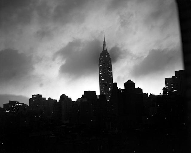 <p>Ominous clouds tower over the Empire State Building high above the New York skyline at dusk, giving warning of the expected arrival of Hurricane Hazel. This photograph was taken from The News Building on 42nd Street. (Photo from Hal Mathewson/NY Daily News via Getty Images) </p>