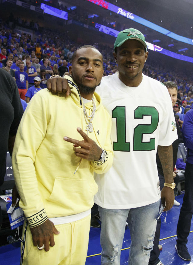 Philadelphia Eagles' DeSean Jackson, left, and Alshon Jeffery, right, look on prior to the first half of Game 3 of a second-round NBA basketball playoff series between the Toronto Raptors and the Philadelphia 76ers, Thursday, May 2, 2019, in Philadelphia. 76ers won 116-95. (AP Photo/Chris Szagola)