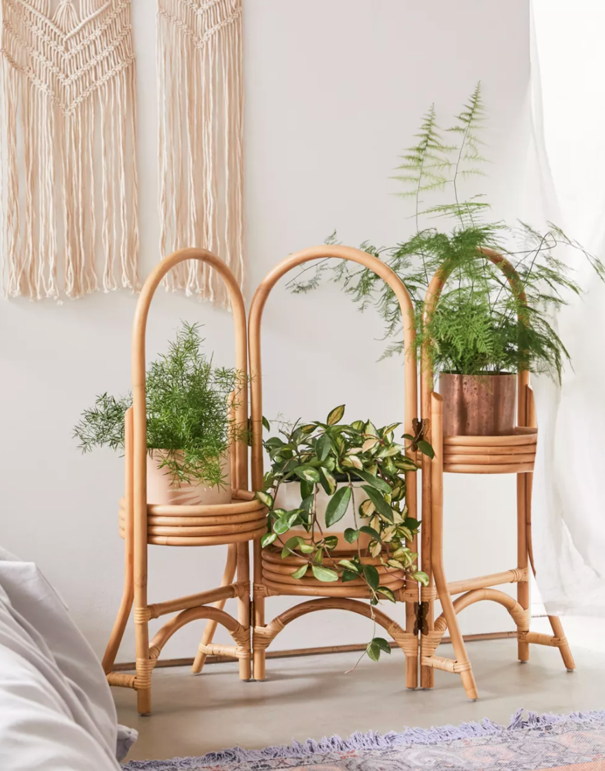 """<br><br><strong>Urban Outfitters</strong> Rattan Plant Stand, $, available at <a href=""""https://go.skimresources.com/?id=30283X879131&url=https%3A%2F%2Fwww.urbanoutfitters.com%2Fshop%2Frattan-plant-stand"""" rel=""""nofollow noopener"""" target=""""_blank"""" data-ylk=""""slk:Urban Outfitters"""" class=""""link rapid-noclick-resp"""">Urban Outfitters</a>"""