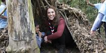 <p>The duchess crouches in a fort built by the Scouts at their London headquarters.</p>