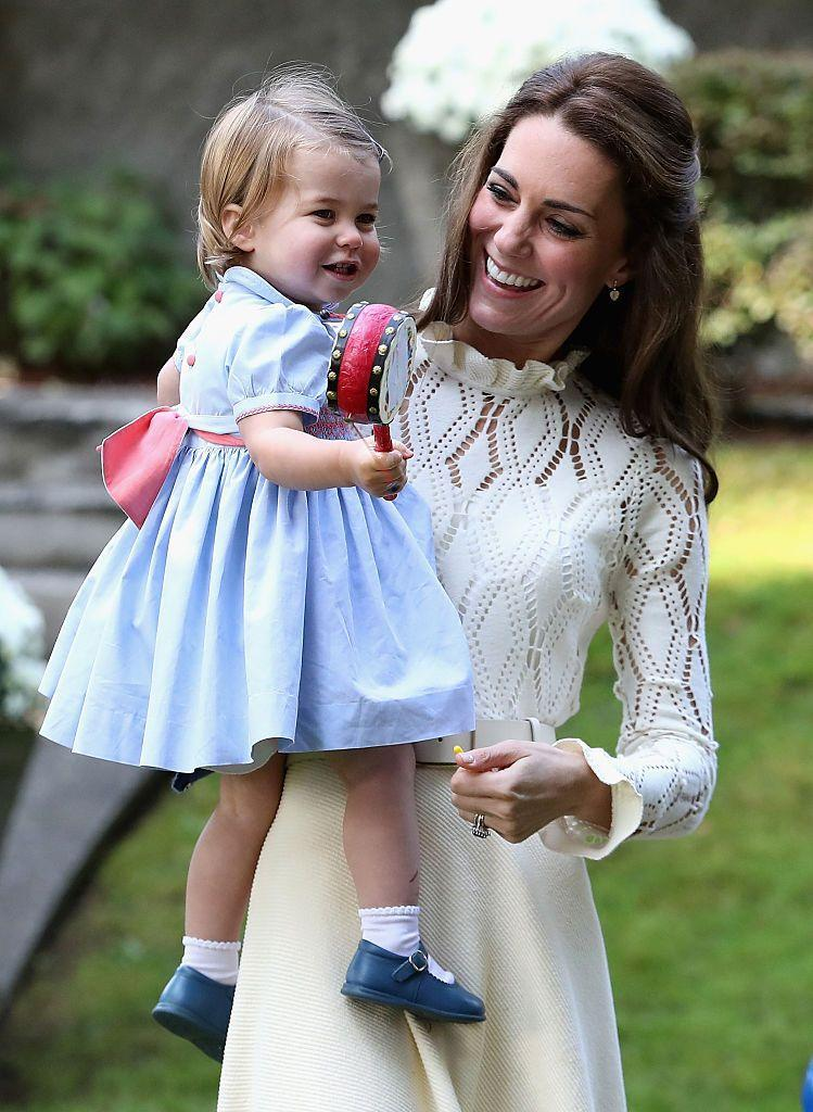 <p>Kate carried her smiling daughter during the Duke and Duchess of Cambridge's royal tour of Canada in September, 2016.</p>