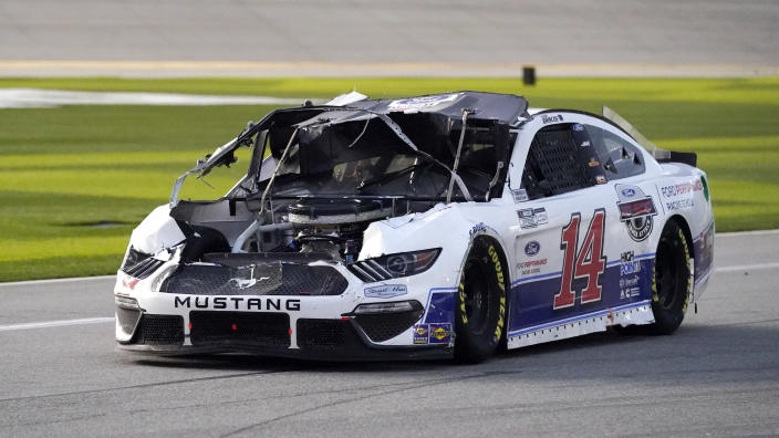 Chase Briscoe (14) drives down pit road to repair damage to his car after he was in a crash during the NASCAR Cup Series road course auto race at Daytona International Speedway, Sunday, Feb. 21, 2021, in Daytona Beach, Fla. (AP Photo/John Raoux)