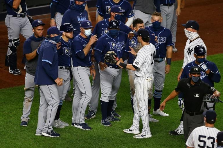 Players from the New York Yankees and Tampa Bay Rays exchange words after the final out Tuesday at Yankee Stadium, a game that led to suspensions for both managers and Yankees pitcher Aroldis Chapman