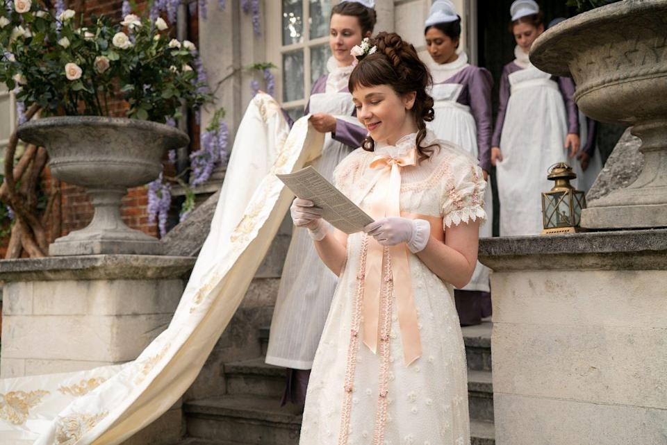 <p>Eloise Bridgerton reads the morning gossip in a perfectly peach-accented getup.</p>