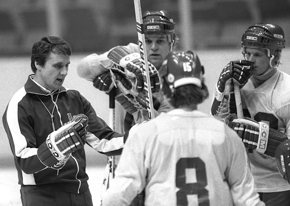 United States Olympic ice hockey coach, Herb Brooks, left, speaks to members of the team during a break in practice at the Ice Hall in Lake Placid, N.Y. in this Feb, 8, 1980 photo. Brooks, who coached the U.S. hockey team to the ``Miracle on Ice'' victory over the Soviet Union at the 1980 Lake Placid Olympics, died Monday, Aug. 11, 2003 in a car wreck, a Minnesota state official said. Brooks was 66. (AP Photo/Douglas Ball)