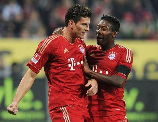 Bayern Munich's Mario Gomez (L) and his teammate David Alaba celebrate scoring