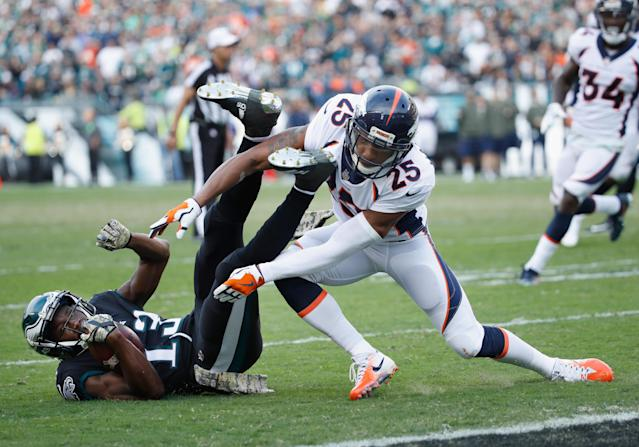 <p>Wide receiver Nelson Agholor #13 of the Philadelphia Eagles holds onto the ball against cornerback Chris Harris #25 of the Denver Broncos during the third quarter at Lincoln Financial Field on November 5, 2017 in Philadelphia, Pennsylvania. (Photo by Joe Robbins/Getty Images) </p>