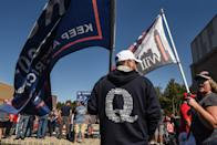 Supporter of President Donald Trump in a QAnon sweatshirt at a rally on Oct. 3, 2020, in Staten Island, New York.