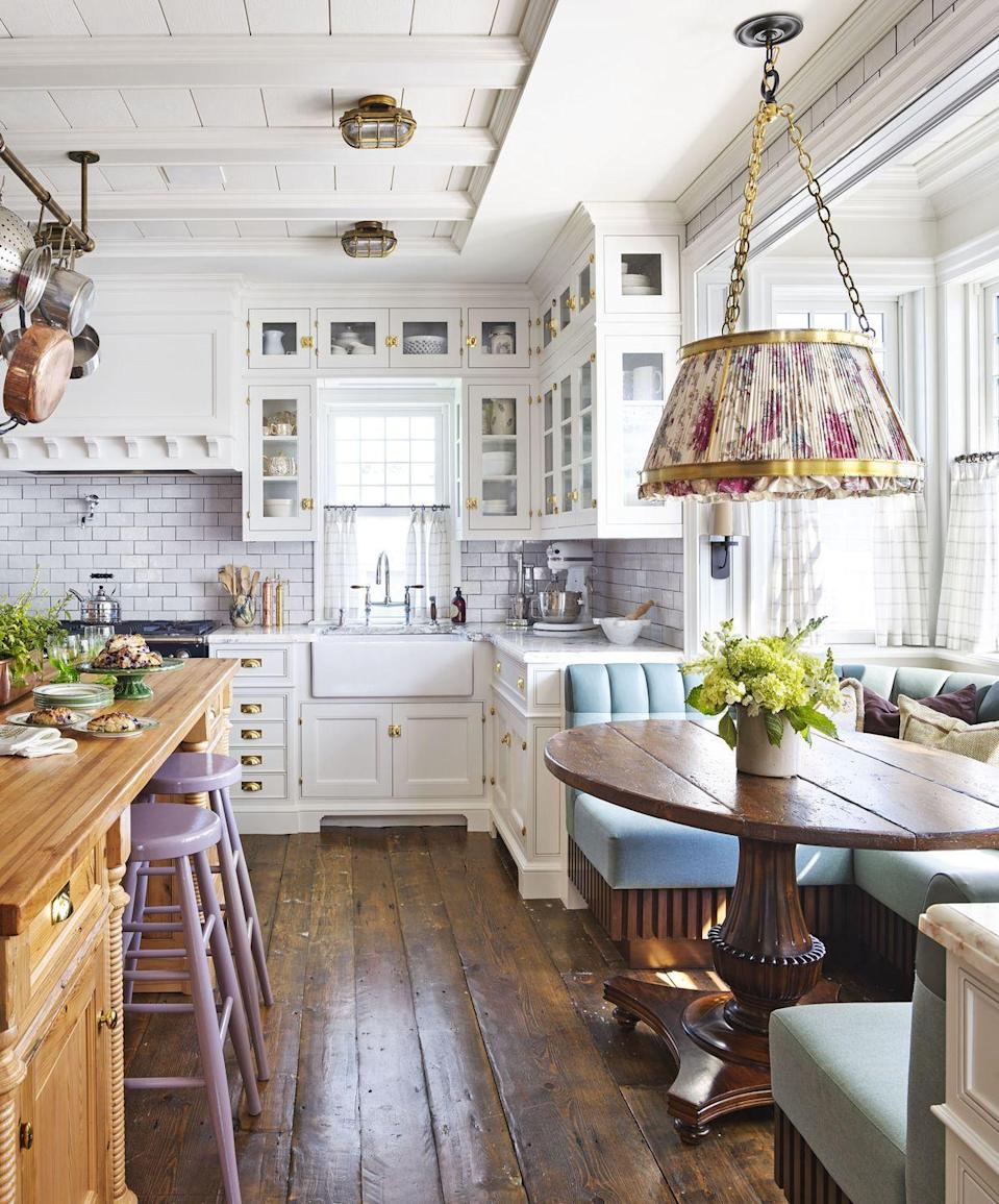 "<p>Designer <a href=""https://philipmitchelldesign.com/"" rel=""nofollow noopener"" target=""_blank"" data-ylk=""slk:Philip Mitchell"" class=""link rapid-noclick-resp"">Philip Mitchell</a> let lively lilac counter stools and a sky-blue tufted banquette shine in the kitchen of his <span>Nova Scotia getaway</span> by pairing them with soft white-painted cabinetry. The ikat pendant shade (custom, <a href=""https://urbanelectric.com/"" rel=""nofollow noopener"" target=""_blank"" data-ylk=""slk:The Urban Electric Co."" class=""link rapid-noclick-resp"">The Urban Electric Co.</a>) sits overhead a table from <a href=""https://www.sharonodowd.com/"" rel=""nofollow noopener"" target=""_blank"" data-ylk=""slk:Sharon O'Dowd"" class=""link rapid-noclick-resp"">Sharon O'Dowd</a>. The backsplash and countertop material both are from <a href=""https://ciot.com/"" rel=""nofollow noopener"" target=""_blank"" data-ylk=""slk:Ciot Habitat"" class=""link rapid-noclick-resp"">Ciot Habitat</a>. The cabinetry paint color is Dune White by Benjamin Moore. </p><p><a class=""link rapid-noclick-resp"" href=""https://www.benjaminmoore.com/en-us/color-overview/find-your-color/color/968/dune-white?color=968"" rel=""nofollow noopener"" target=""_blank"" data-ylk=""slk:Get the Look"">Get the Look</a></p>"