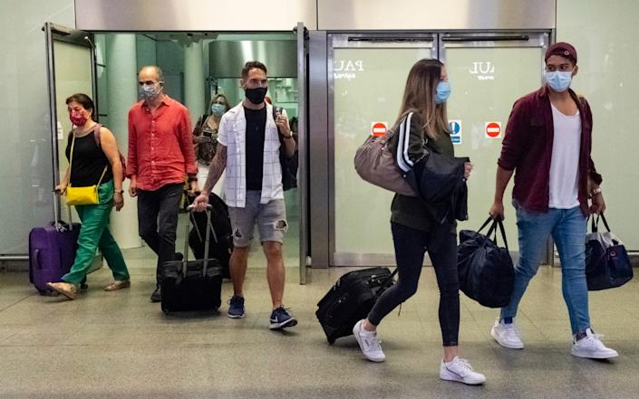 people at airport - London News Pictures