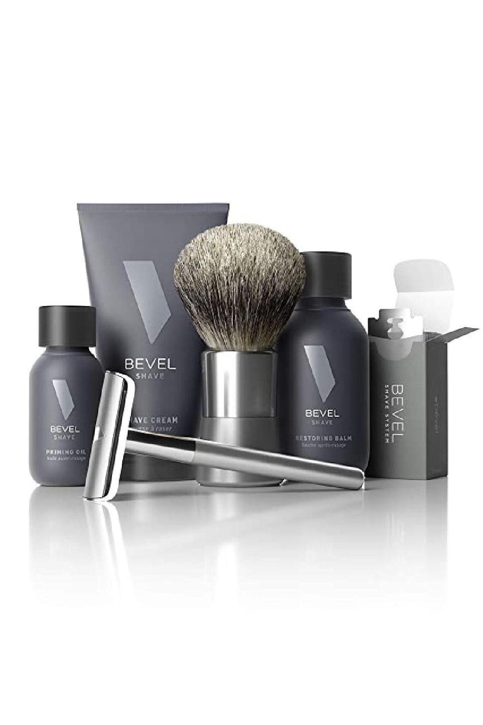"""<p><strong>Bevel</strong></p><p>amazon.com</p><p><strong>$89.99</strong></p><p><a href=""""https://www.amazon.com/dp/B00IT8K564?tag=syn-yahoo-20&ascsubtag=%5Bartid%7C10049.g.5199%5Bsrc%7Cyahoo-us"""" rel=""""nofollow noopener"""" target=""""_blank"""" data-ylk=""""slk:Shop Now"""" class=""""link rapid-noclick-resp"""">Shop Now</a></p><p>Now he can give his beard all the love and attention it needs with a fancy grooming kit that includes a safety razor with 20 blades, oil, balm, and a brush. <br></p>"""