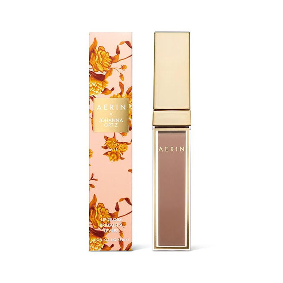 """<p>If you've ever caught yourself salivating over one of Johanna Ortiz's fluttery, floral dresses in Saks window, you're in luck. For the second time, the fashion designer collaborated with Aerin on a pair of limited-edition lip products, including this creamy and pigmented gloss called Candelaria Nude.</p> <p><strong>$30</strong> (<a href=""""https://www.neimanmarcus.com/p/aerin-aerin-x-johanna-ortiz-lipgloss-prod226360072"""" rel=""""nofollow"""">Shop Now</a>)</p>"""