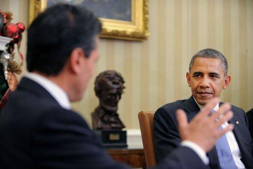 "US President Barack Obama listens to President-elect Enrique Pena Nieto of Mexico during a bilateral meeting in the Oval Office at the White House in Washington. Obama noted the ""ambitious"" reform agenda of Mexico's president-elect Enrique Pena Nieto, as he welcomed him to the White House four days ahead of his inauguration"
