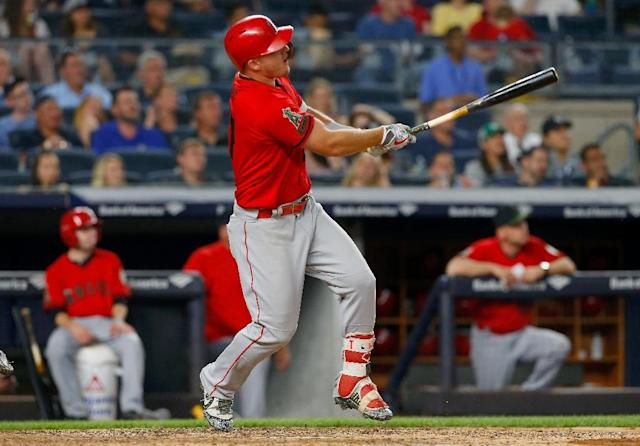 Mike Trout of the Los Angeles Angels follows through on a fourth inning two-run home run against the New York Yankees at Yankee Stadium on May 26, 2018 (AFP Photo/Jim McIsaac)