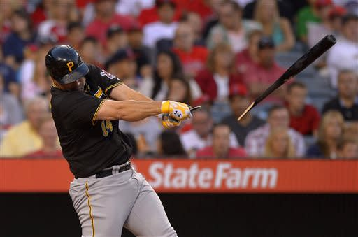 Pittsburgh Pirates' Gaby Sanchez breaks his bat for a foul ball during the fourth inning of their baseball game against the Los Angeles Angels, Saturday, June 22, 2013, in Anaheim, Calif. (AP Photo/Mark J. Terrill)
