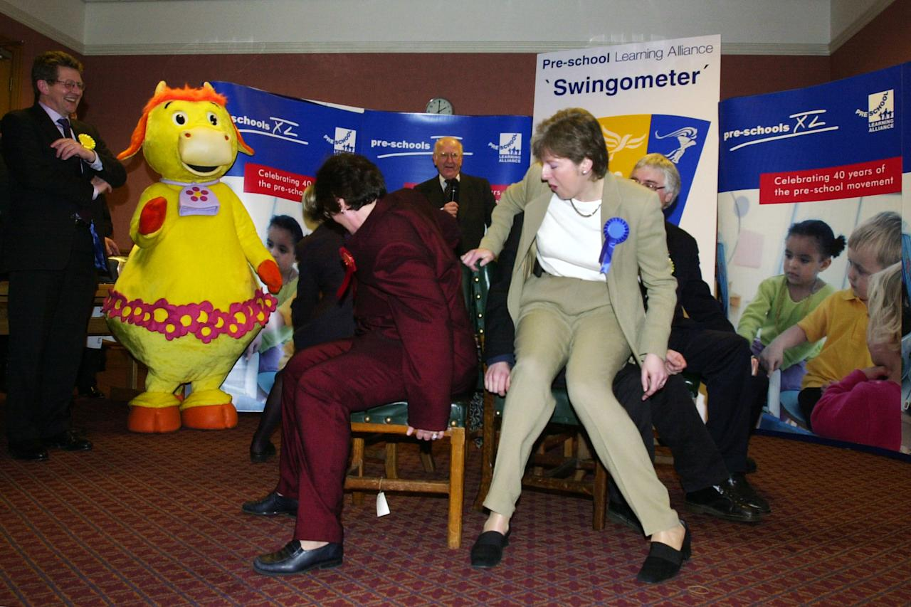 During a game of musical chairs Theresa May landed in the lap of Richard Allan, Lib Dem MP for Sheffield Hallam, as they tussled for a seat. Photo dated 23/01/2001 (PA)