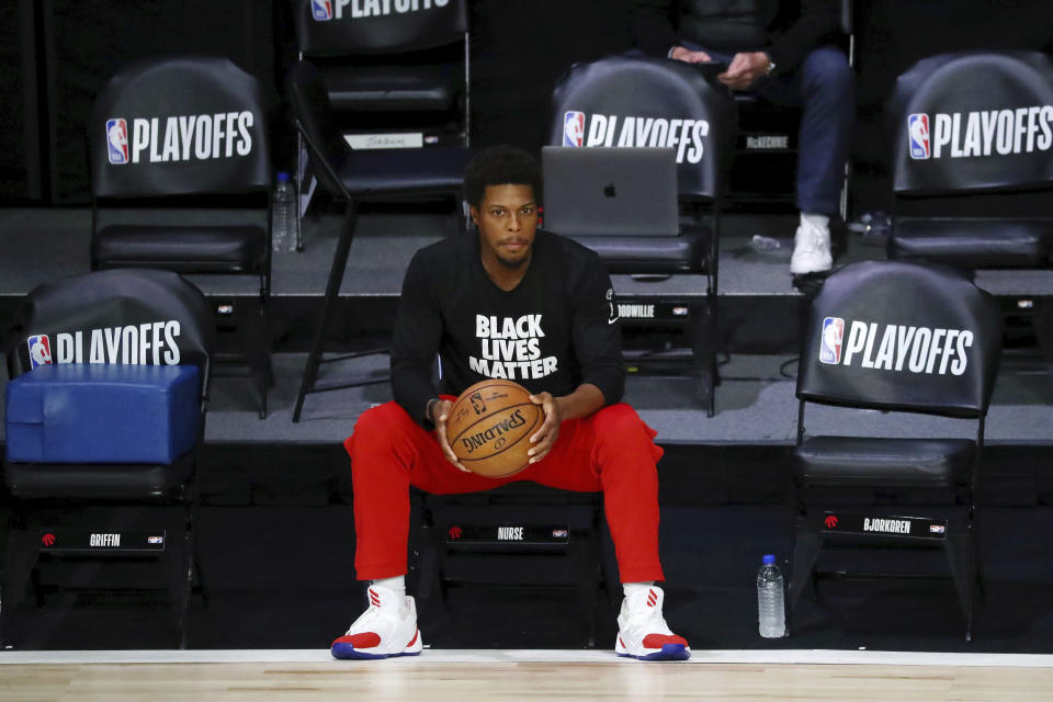 Toronto Raptors guard Kyle Lowry (7) looks on before Game 3 of an NBA basketball first-round playoff series against the Brooklyn Nets, Friday, Aug. 21, 2020, in Lake Buena Vista, Fla. (Kim Klement/Pool Photo via AP)