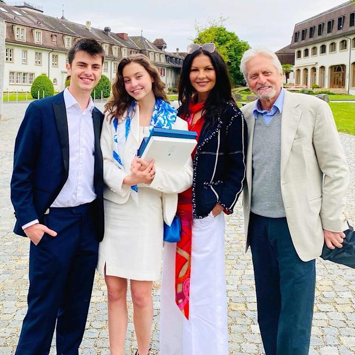 """<p>The proud parents commemorated their 18-year-old daughter Carys' <a href=""""https://people.com/movies/michael-douglas-catherine-zeta-jones-daughter-carys-graduates-high-school-family-photos/"""" rel=""""nofollow noopener"""" target=""""_blank"""" data-ylk=""""slk:high school graduation"""" class=""""link rapid-noclick-resp"""">high school graduation</a> with a sweet <a href=""""https://www.instagram.com/p/CPI_Ocss6Di/"""" rel=""""nofollow noopener"""" target=""""_blank"""" data-ylk=""""slk:Instagram tribute"""" class=""""link rapid-noclick-resp"""">Instagram tribute</a> on each of their accounts. </p> <p>""""Congratulations to Carys and the entire class of 2021! Your Mom and I are so proud of you! We love you so much and we are so excited for your future as the best is yet to come! ❤️ Dad,"""" wrote <i>The Kominsky Method </i>star. </p> <p>On her <a href=""""https://www.instagram.com/p/CPJD939rIgu/"""" rel=""""nofollow noopener"""" target=""""_blank"""" data-ylk=""""slk:Instagram"""" class=""""link rapid-noclick-resp"""">Instagram</a> profile, the <i>Mask of Zorro </i>actress added, """"Carys!!! What a proud day as our daughter Carys graduates with honors for her International Baccalaureate! You rock and we love you. 👩🎓👩🎓👩🎓.""""</p>"""