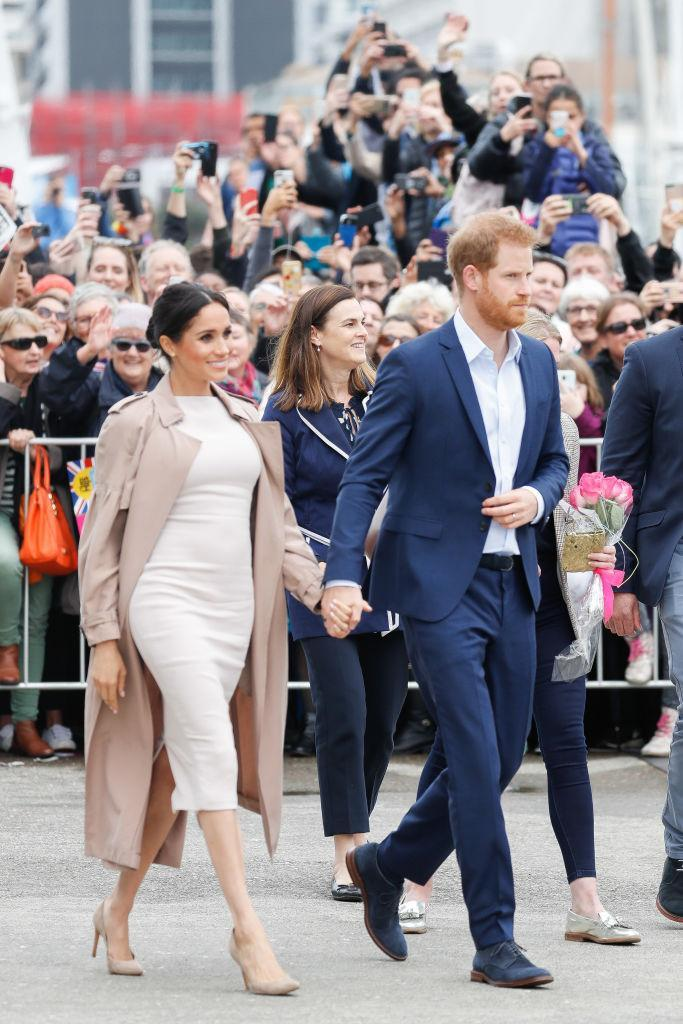 <p>For a walkabout in Auckland on October 30, Meghan changed into a bespoke Brandon Maxwell dress with a Burberry trench and her go-to £294 Stuart Weitzman pumps to finish. <em>[Photo: Getty]</em> </p>