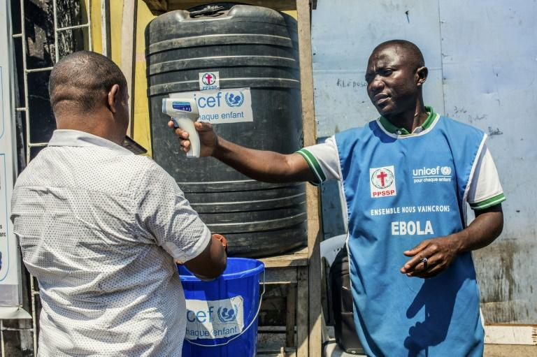 Ebola guidelines include checking temperatures and washing hands (AFP Photo/Pamela TULIZO)