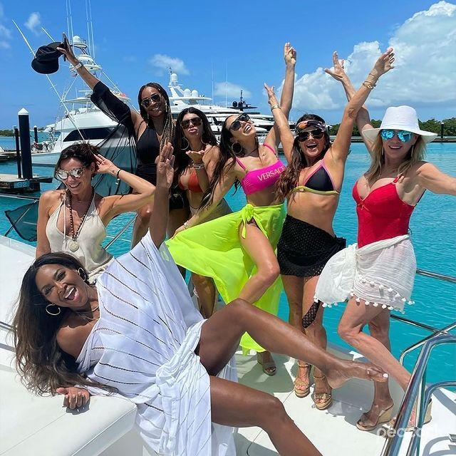 """<p>Bravoholics are absolutely losing it over this group shot with every A-list Housewife from your favorite cities. We've got (from right to left) Ramona Singer, Kyle Richards, Melissa Gorga, Teresa Giudice and Cynthia Bailey partying it up, while Luann de Lesseps and Kenya Moore strike their top-model poses on a large luxury yacht in Turks and Caicos. The women <a href=""""https://people.com/tv/ramona-singer-teresa-giudice-more-real-housewives-stars-confirmed-to-appear-in-all-stars-spinoff/"""" rel=""""nofollow noopener"""" target=""""_blank"""" data-ylk=""""slk:came together for a week at the end of April"""" class=""""link rapid-noclick-resp"""">came together for a week at the end of April</a> to film a <em>Housewives</em> all-stars spin-off to air on Peacock. </p>"""