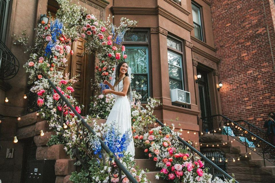 """<p>Despite a global pandemic, Elaine Welteroth wed musician Jonathan Singletary on their Brooklyn stoop with the help of friends, family, and an amazing team. Using a vibrant floral installation framing their home's doorway, stemming from the sidewalk, this look is proof that you don't have to have a grand venue to create a show-stopping aisle. </p><p>For those not venturing too far from home, consider bringing high-design to your doorstep, and having your very own walkway double as your ceremony marker.<br></p><p>Pictured: Planning by <a href=""""https://jzevents.com/"""" rel=""""nofollow noopener"""" target=""""_blank"""" data-ylk=""""slk:JZ Events"""" class=""""link rapid-noclick-resp"""">JZ Events</a>; Floral design by <a href=""""https://www.instagram.com/lewismillerdesign/?hl=en"""" rel=""""nofollow noopener"""" target=""""_blank"""" data-ylk=""""slk:Lewis Miller Design"""" class=""""link rapid-noclick-resp"""">Lewis Miller Design</a>.</p>"""