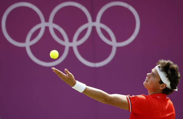 LONDON, ENGLAND - JULY 30: Milos Raonic of Canada serves during the Men's Singles Tennis match against Tatsuma Ito of Japan on Day 3 of the London 2012 Olympic Games at the All England Lawn Tennis and Croquet Club in Wimbledon on July 30, 2012 in London, England. (Photo by Jamie Squire/Getty Images)