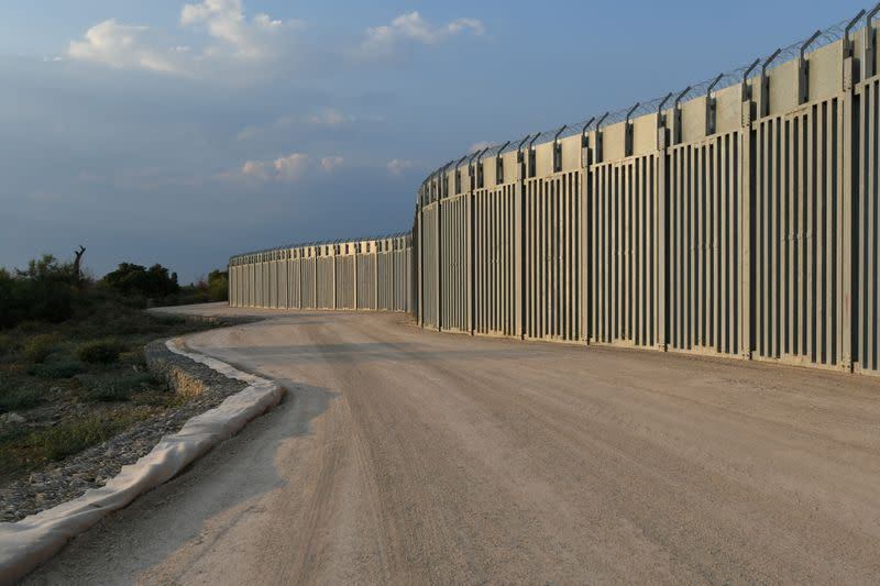 FILE PHOTO: View of a border fence between Greece and Turkey, in Alexandroupolis