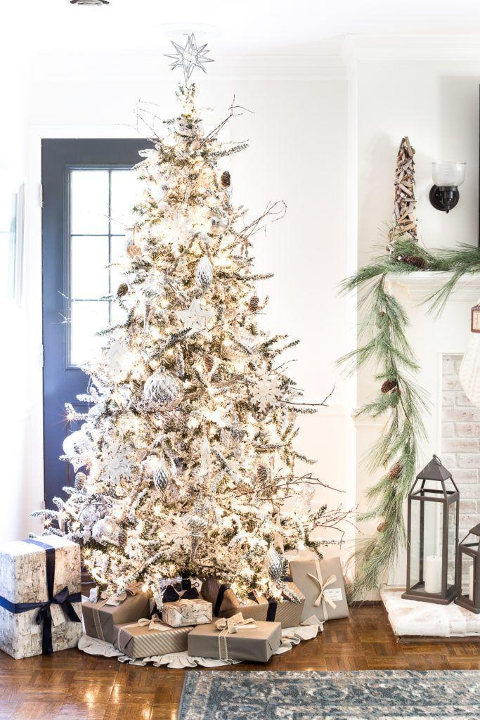 """<p>Stick in twigs of all shapes and sizes to make your narrow Christmas tree — real or fake — look more full. </p><p><em><a href=""""https://www.blesserhouse.com/seasonal-simplicity-christmas-living-room/"""" rel=""""nofollow noopener"""" target=""""_blank"""" data-ylk=""""slk:Get the tutorial at Bless'er House »"""" class=""""link rapid-noclick-resp"""">Get the tutorial at Bless'er House »</a></em></p>"""