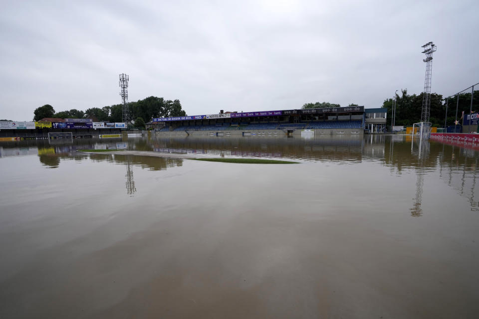 A soccer stadium is full of water after flooding in Tienen, Belgium, Friday, July 16, 2021. Severe flooding in Germany and Belgium has turned streams and streets into raging torrents that have swept away cars and caused houses to collapse. (AP Photo/Virginia Mayo)