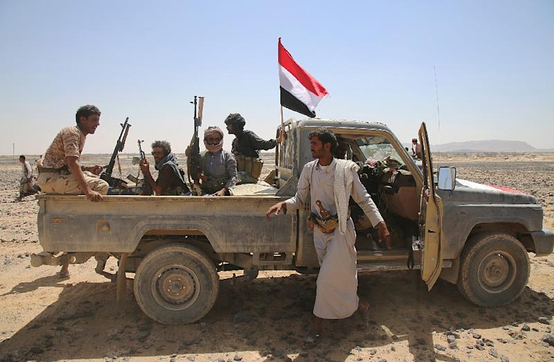 Armed Yemeni tribesmen from the Popular Resistance Committees, supporting forces loyal to Yemen's Saudi-backed President Abedrabbo Mansour Hadi, monitor the area of Algevinh in Marib province, east of the capital, Sanaa, on October 11, 2015