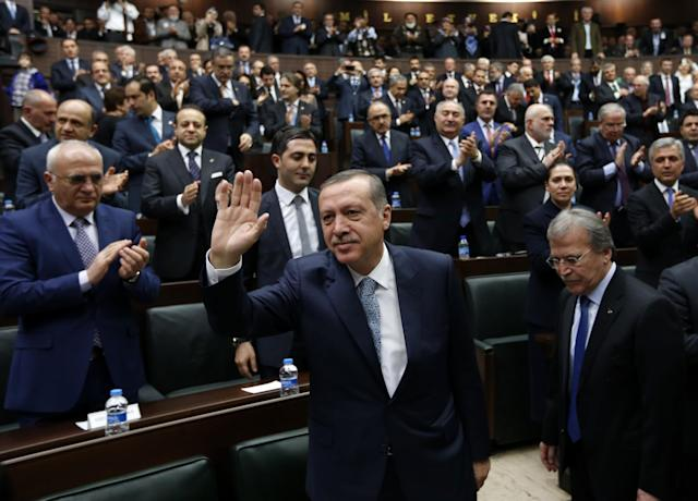 "<p>Turkey's Prime Minister Tayyip Erdogan greets his supporters as he arrives for a meeting at the Turkish parliament in Ankara February 25, 2014. Erdogan said on Tuesday voice recordings purportedly of him telling his son to dispose of large sums of money on the day news broke of a graft inquiry were a ""treacherous attack"" on his office. (Umit Bektas/Reuters) </p>"