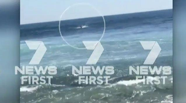 Shocking footage shows thrashing in the water as someone yells for the surfers to come in. Photo: 7 News