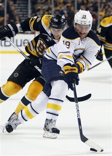 Boston Bruins' Jordan Caron, left, chases Buffalo Sabres' Cody Hodgson (19) during the first period of an NHL hockey game in Boston, Thursday, March 8, 2012. (AP Photo/Michael Dwyer)
