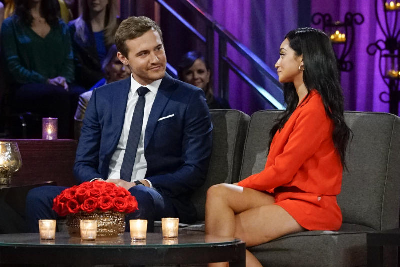 """Bachelor"" star Peter Weber speaks with Victoria F. at the taping of a ""Bachelor"" special. (Photo: ABC/Kelsey McNeal)"