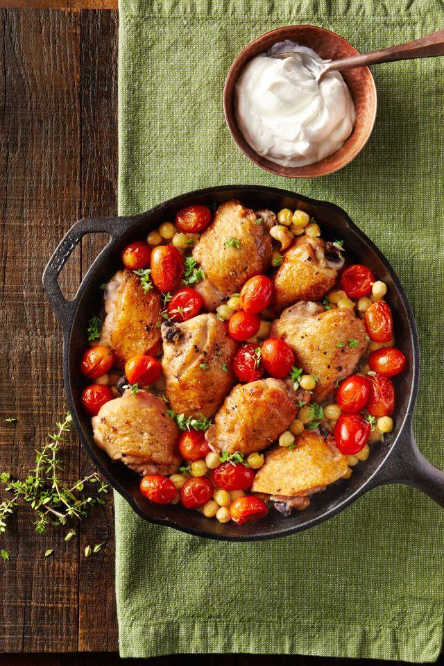 """<p>Warm up and wind down with this simple yet hearty weeknight meal.</p><p><strong><a href=""""https://www.countryliving.com/food-drinks/recipes/a41025/crispy-chicken-thighs-with-smoky-chickpeas/"""" rel=""""nofollow noopener"""" target=""""_blank"""" data-ylk=""""slk:Get the recipe"""" class=""""link rapid-noclick-resp"""">Get the recipe</a>.</strong></p>"""