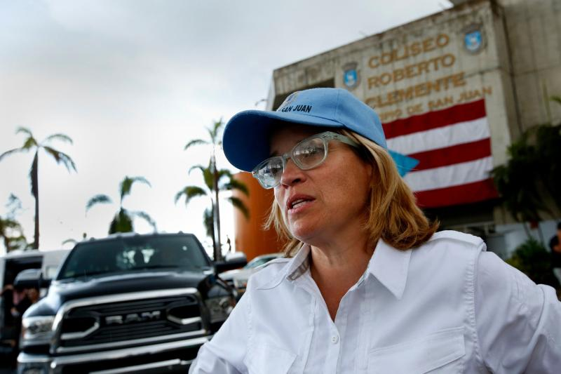 San Juan Mayor Carmen Yulín Cruzoutside the Coliseo Roberto Clemente, a stadium that's been functioning as the city's headquarters for supply distribution.