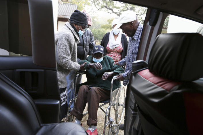 """An elderly man prepares to be transported to hospital at the Society for the Destitute Aged care home in Harare's Highfiled township, Tuesday, June, 22, 2021. The economic ravages of COVID-19 are forcing some families in Zimbabwe to abandon the age-old tradition of taking care of their older people. Some roam the streets. The lucky ones end up at facilities for older people. They were once widely viewed by many Zimbabweans as """"un-African"""" and against the social bonds that have held extended families together for generations. (AP Photo/Tsvangirayi Mukwazhi)"""
