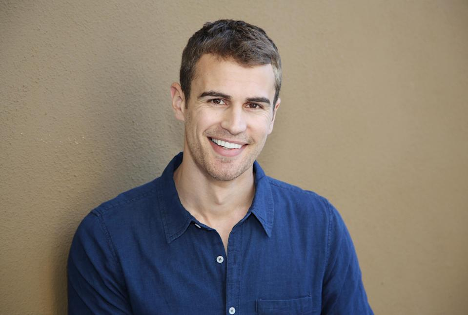 """In this Saturday, March 8, 2014 photo, actor Theo James poses for a photo in Beverly Hills, Calif. The soulful Brit James, the star of the buzzed about """"Divergent,"""" is being set up as Hollywood next heartthrob. The film adaptation of Veronica Roth's sci-fi best-seller hits theaters on Friday, March 21, 2014. (Photo by Annie I. Bang /Invision/AP)"""