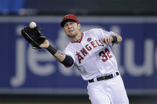 Los Angeles Angels right fielder Josh Hamilton misses a ball hit by Boston Red Sox's Jonny Gomes during the seventh inning of a baseball game in Anaheim, Calif., Friday, July 5, 2013. Boston Red Sox's Shane Victorino scored on the fielding error by Hamilton. (AP Photo/Jae C. Hong)
