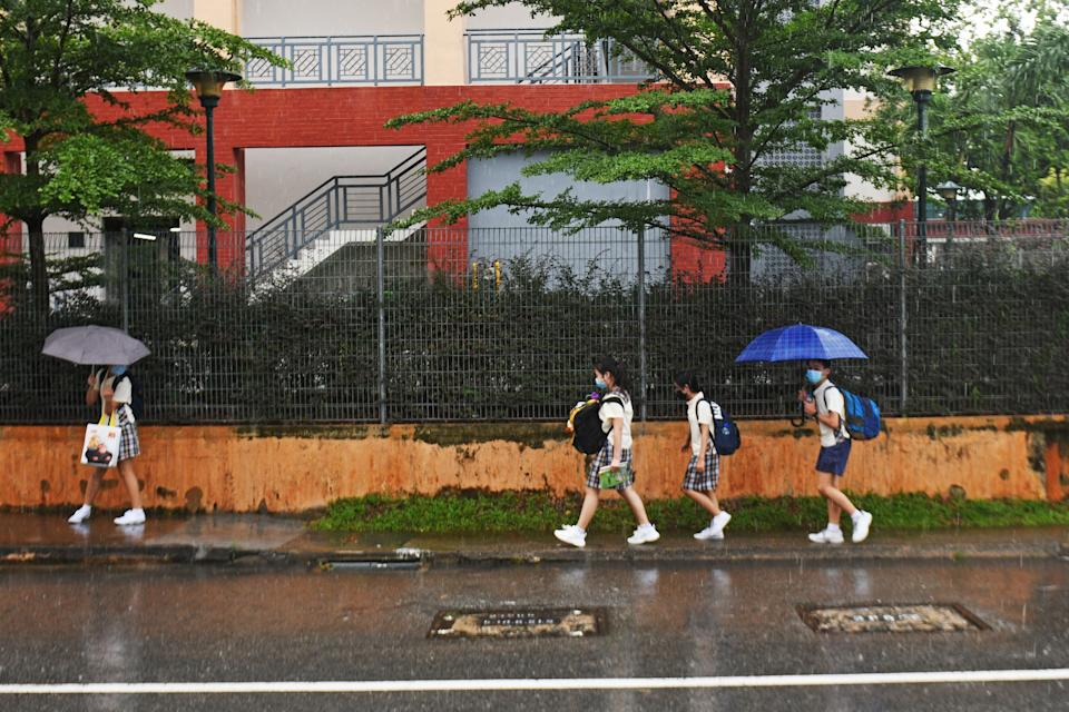 Pupils leave their school after class in Singapore.