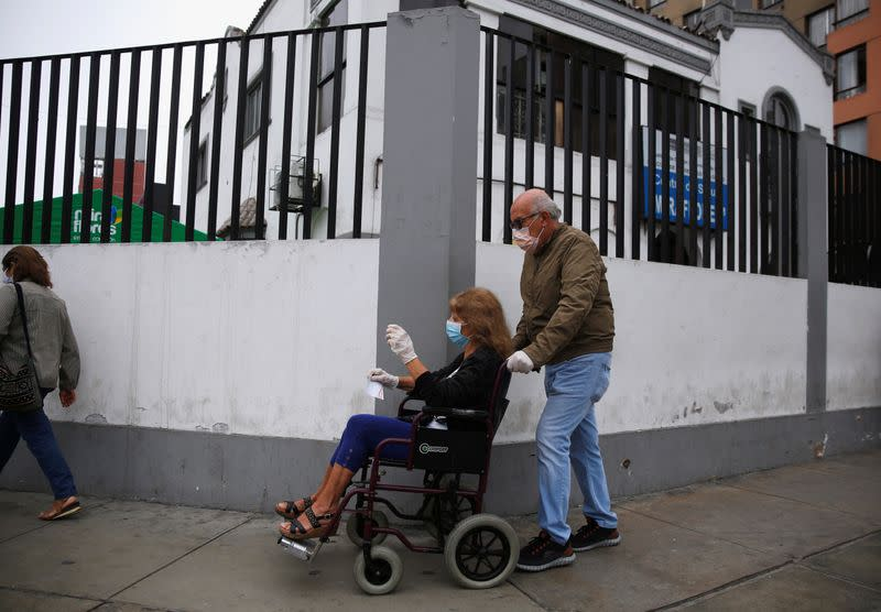 An eldery patient is brought into a health center after the Peruvian government closed the country's borders in response to the outbreak of coronavirus disease (COVID-19), in Lima