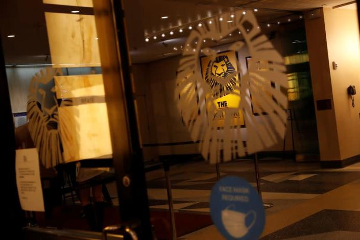 """The inside lobby of the Broadway show """"The Lion King"""" is seen through an entrance door in the Times Square area of Manhattan, New York City"""