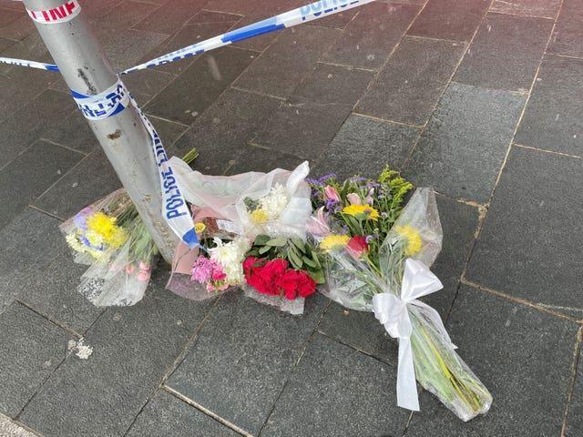 Flowers left near the scene at Woolwich New Road