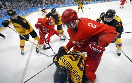 Ice Hockey - Pyeongchang 2018 Winter Olympics - Men Final Match - Olympic Athletes from Russia v Germany - Gangneung Hockey Centre, Gangneung, South Korea - February 25, 2018 - Germany's Yannic Seidenberg and Artyom Zub, an Olympic Athlete from Russia, compete. REUTERS/Kim Kyung-Hoon